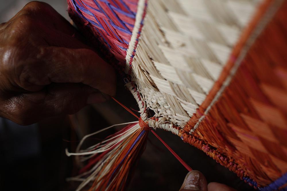 Barreirinhas_MA, Brasil.<br /> <br /> Processo de fabricao de artesanato de buriti no povoado de Marcelino. Na foto, artesa trabalha a fibra do Buriti usando um tear e a  e a tecnica de Malha de Cascudo.<br /> <br /> The manufacture of handicrafts process in the Buriti Marcelino Village. In this photo art of making Malha de Cascudo.<br /> <br /> Foto: LEO DRUMOND / NITRO