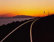 Alaska. Turnagain Arm. Alaska Railroad Tracks with Mt Susitna in a sunset distance.