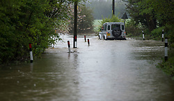 © London News Pictures. 29/04/2012. Ingatestone, UK. A  Land Rover driving through flood water on a road near the town of Ingateston in Essex on April 29, 2012 . The nearby river Wid broke it's banks following torrential rainfall. Photo credit : Ben Cawthra /LNP