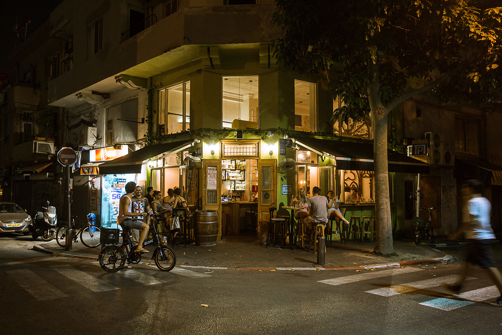 People are seen hanging out at Pimpinella, a bar and restaurant in Tel Aviv's Florentine neighborhood