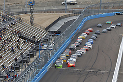 March 10, 2018 - Avondale, Arizona, United States of America - March 10, 2018 - Avondale, Arizona, USA: Brad Keselowski (22) and Justin Allgaier (7) lead the field to turn one on a restart during the DC Solar 200 at ISM Raceway in Avondale, Arizona. (Credit Image: © Chris Owens Asp Inc/ASP via ZUMA Wire)