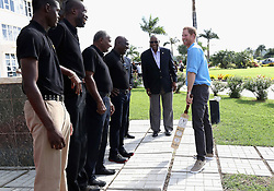 Prince Harry meets cricket legends Sir Curtly Ambrose (second left), Sir Anderson Roberts (third left) and Sir Vivian Richards (fourth left) as he attends a youth sports festival at the Sir Vivian Richards Stadium in North Sound, Antigua, on the second day of his tour of the Caribbean.