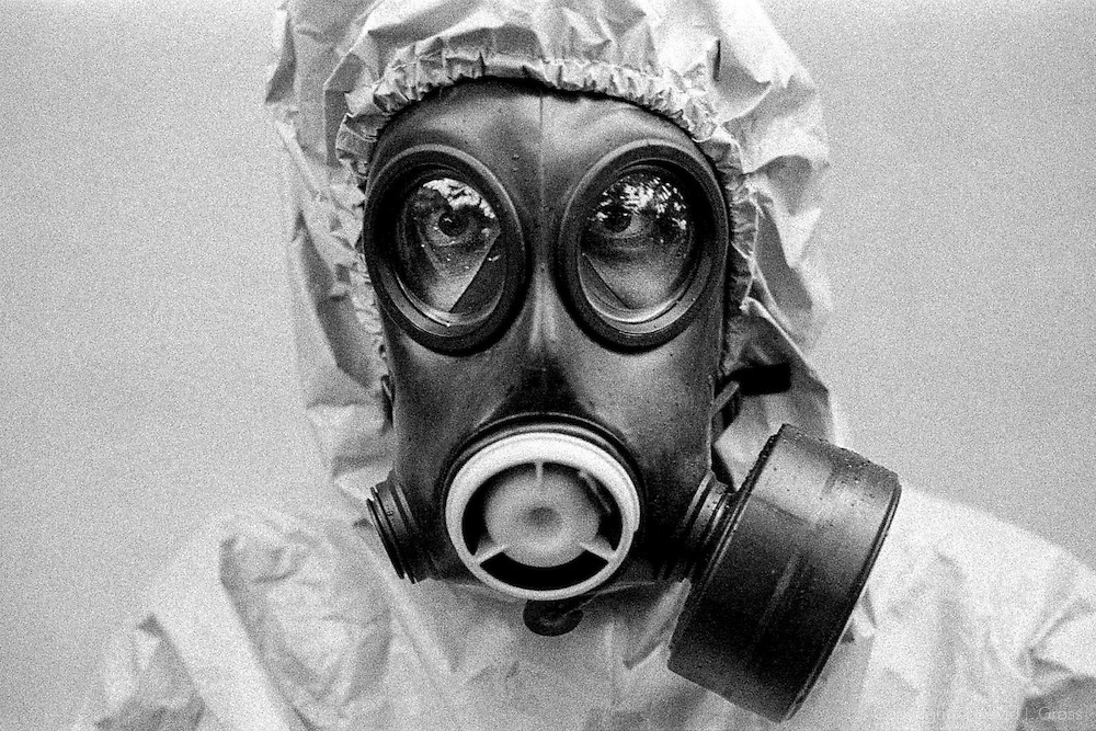 Journalist Owen Matthews dons a biological/chemical protective suit as part of his preparation to cover the expected war in Iraq.