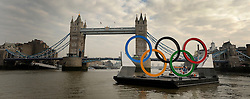 © Licensed to London News Pictures. 28/02/2012, London, UK. A view with Tower Bridge. Giant Olympic rings measuring 11 metres high by 25 metres wide are floated down the River Thames on a barge, marking 150 days to go to the start of the London 2012 Olympic and Paralympic Games. Photo credit : Stephen Simpson/LNP