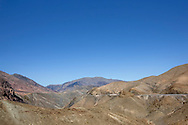 Tizi-n-Tichka pass in the High Atlas Mountains against clear blue sky, Morocco.