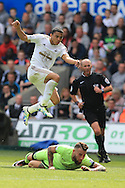 Jefferson Montero of Swansea city shoots past Nicolas Otamendi  of Manchester city .Barclays Premier league match, Swansea city v Manchester city at the Liberty Stadium in Swansea, South Wales on Sunday 15th May 2016.<br /> pic by Andrew Orchard, Andrew Orchard sports photography.