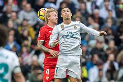 (L-R) Simon Kjaer of Sevilla FC, Cristiano Ronaldo dos Santos Aveiro of Real Madrid during the La Liga Santander match between Real Madrid CF and Sevilla FC on December 09, 2017 at the Santiago Bernabeu stadium in Madrid, Spain.