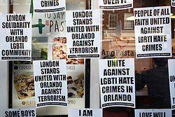 © Licensed to London News Pictures. 13/06/2016. Posters on a shop window honour and support victims of Pulse shooting in the United States.  It is alleged that The gunman, Omar Mateen killed at least 50 people in Pulse nightclub in Florida, USA.  London, UK. Photo credit: Ray Tang/LNP
