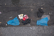 """April, 9th 2020 - Paris, Ile-de-France, France: Masks and gloves thrown away on the sidewalk during the Coronavirus pandemic. Used protection from the spread of the Coronavirus, during the third week of near total lockdown imposed in France. A week after President of France, Emmanuel Macron, said the citizens must stay at home for at least 15 days, that has been extended. He said """"We are at war, a public health war, certainly but we are at war, against an invisible and elusive enemy"""". All journeys outside the home unless justified for essential professional or health reasons are outlawed. Anyone flouting the new regulations is fined. Nigel Dickinson"""