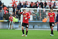 Wayne Rooney of Manchester Utd walks off dejected at end of match having lost by 2-1 to Swansea again. Barclays Premier League match, Swansea city v Manchester Utd at the Liberty Stadium in Swansea, South Wales on Sunday 30th August  2015.<br /> pic by Andrew Orchard, Andrew Orchard sports photography.