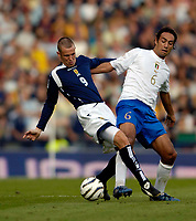 Photo: Jed Wee.<br />Scotland v Italy. FIFA World Cup Qualifying match. <br />03/09/2005.<br /><br />Scotland's Kenny Miller (L) gave Italy's Alessandro Nesta immense difficulties all afternoon.