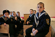 Kronstadt, Russia, 21/02/2004..11 year old Ivan Mishukov is a student at the Naval Kadetskii Korpus, the school of the elite Kronstadt Naval Academy. Abandoned by his alcoholic parents at the age of 3, Ivan lived for 2 years with a pack of wild dogs in his home town of Reutov before being rescued by police and taken to a children's home; he was subsequently adopted by Tatiana Bababina..Ivan in his room with his classmates.