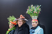 New York, NY, USA-27 March 2016. Three women wearing hats decorated with several spring themes in the annual Easter Bonnet Parade and Festival.