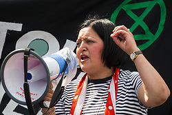 London, UK. 5th June, 2021. Rokhsana Fiaz, Mayor of Newham, addresses environmental activists and local residents protesting against the construction of the Silvertown Tunnel. Campaigners opposed to the controversial new £2bn road link across the River Thames from the Tidal Basin Roundabout in Silvertown to Greenwich Peninsula argue that it is incompatible with the UK's climate change commitments because it will attract more traffic and so also increased congestion and air pollution to the most polluted borough of London.