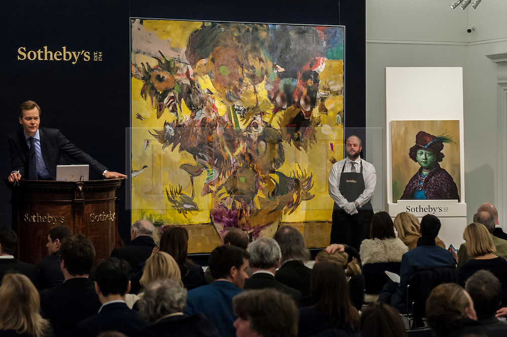 """© Licensed to London News Pictures. 10/02/2016. London, UK.  (L to R) Adrian Ghenie's """"The Sunflowers"""" and Glenn Brown's """"Joseph Beuys"""", which sold for a hammer price of £14.2m and £0.5m respectively, at Sotheby's Contemporary Art evening sale in New Bond Street.   Photo credit : Stephen Chung/LNP"""