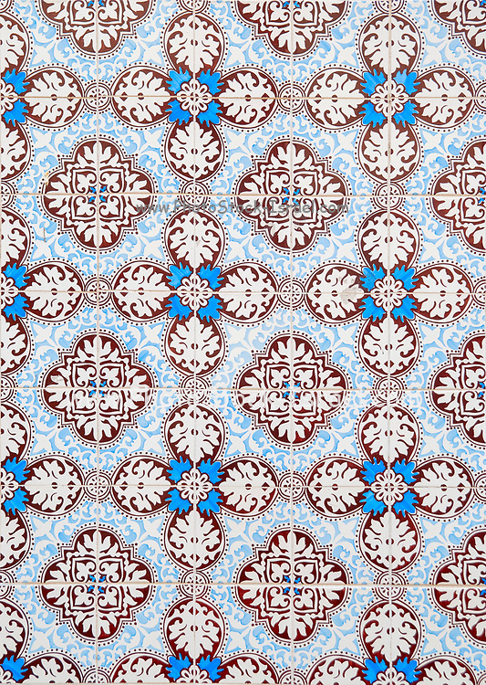 Traditional blue and red Portuguese seamless ceramic tiles used to decorate the outside walls of houses and buildings. Photographed in Portugal