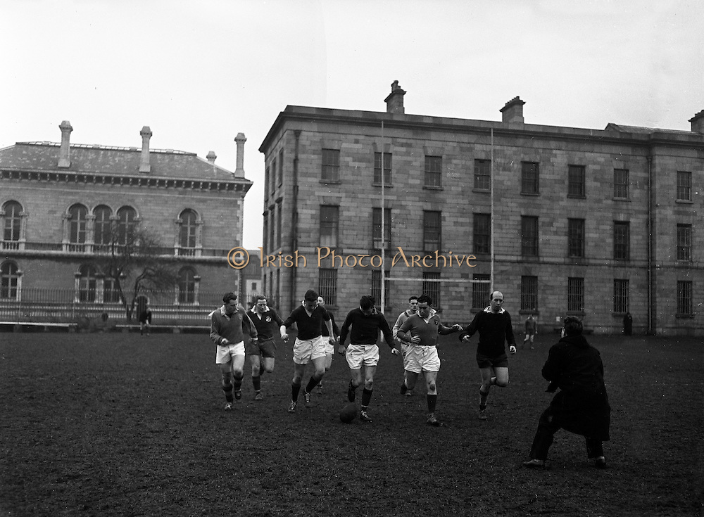 Irish Rugby Football Union, Ireland v Wales, Five Nations, Irish team practice, Dublin, Ireland, Friday 14th March, 1958,.14.3.1958, 3.14.1958,.  .Irish Team, ..J G M W Murphy, Wearing number 15 Irish jersey, Full Back, London Irish Rugby Football Club, Surrey, England, ..A J O'Reilly, Wearing number 14 Irish jersey, Right Wing, Old Belvedere Rugby Football Club, Dublin, Ireland,  ..N J Henderson, Wearing number 13 Irish jersey, Captain of the Irish team, Right centre, N.I.F.C, Rugby Football Club, Belfast, Northern Ireland, ..D Hewitt, Wearing number 12 Irish jersey, Left centre, Queens University Rugby Football Club, Belfast, Northern Ireland,..A C Pedlow, Wearing number 11 Irish jersey, Left wing,  C I Y M S Rugby Football Club, Belfast, Northern Ireland, ..M A English, Wearing number 10 Irish jersey, Outside Half, Bohemians Rugby Football Club, Limerick, Ireland, ..J A O'Meara, Wearing number 9 Irish jersey, Scrum Half, Dolphin Rugby Football Club, Cork, Ireland, ..P J O'Donoghue, Wearing  Number 1 Irish jersey, Forward, Bective Rangers Rugby Football Club, Dublin, Ireland, ..A R Dawson, Wearing number 2 Irish jersey, Forward, Wanderers Rugby Football Club, Dublin, Ireland, . .B G Wood, Wearing number 3 Irish jersey, Forward, Garryowen Rugby Football Club, Limerick, Ireland, ..J B Stevenson, Wearing number 4 Irish jersey, Forward, Instonians Rugby Football Club, Belfast, Northern Ireland,..W A Mulcahy, Wearing number 5 Irish jersey, Forward, University College Dublin Rugby Football Club, Dublin, Ireland, ..J A Donaldson, Wearing number 6 Irish jersey, Forward, Collegians Rugby Football Club, Belfast, Northern Ireland, ..J R Kavanagh, Wearing number 7 Irish jersey, Forward, Wanderers Rugby Football Club, Dublin, Ireland, ..N A Murphy, Wearing number 8 Irish jersey, Forward, Cork Constitution Rugby Football Club, Cork, Ireland,.