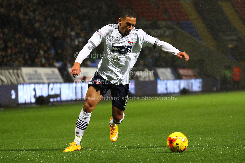 Liam Feeney of Bolton Wanderers looks to cross the ball. Skybet football league championship match, Bolton Wanderers v Ipswich Town at the Macron stadium in Bolton, Lancs on Saturday 13th December 2014.<br /> pic by Chris Stading, Andrew Orchard sports photography.