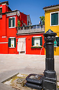 Colorful houses and fountain, Burano, Veneto, Italy