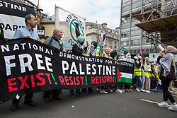 London, UK. 26th June, 2021. Pro-Palestinian activists from Palestine Solidarity Campaign join thousands of people attending a United Against The Tories national demonstration organised by the People's Assembly Against Austerity in protest against the policies of Prime Minister Boris Johnson's Conservative government. The demonstration contained blocs from organisations and groups including Palestine Solidarity Campaign, Stand Up To Racism, Stop The War Coalition, Extinction Rebellion, Kill The Bill and Black Lives Matter as well as from trade unions Unite and the CWU.