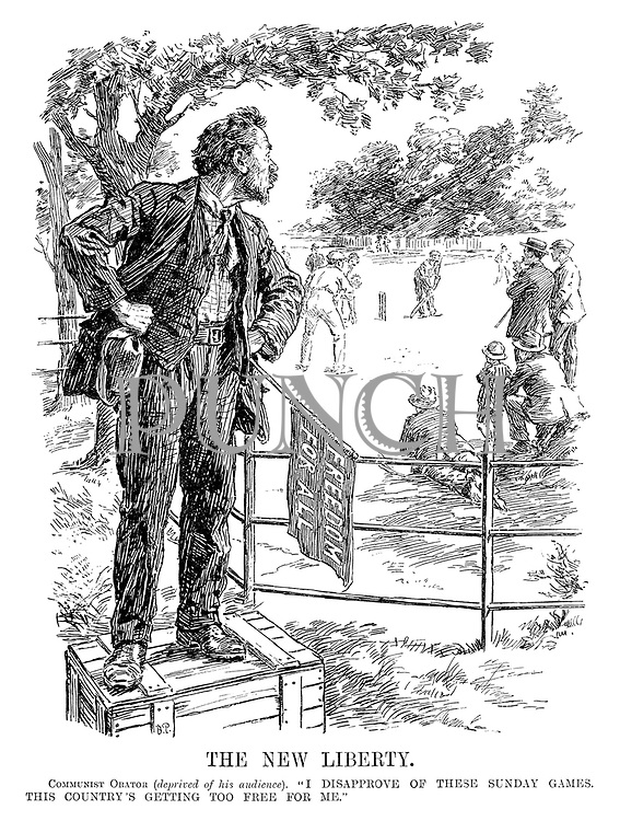 """The New Liberty. Communist Orator (deprived of his audience). """"I disapprove of these Sunday games. This country's getting too free for me."""" (He stands on a soapbox with 'Freedom for All' flag)"""