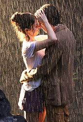 Selena Gomez and Timothee Chalamet passionately kiss during a rain scene for Woody Allen's Untitled Project in Manhattan's Central Park. 26 Sep 2017 Pictured: Selena Gomez and Timothee Chalamet. Photo credit: LRNYC / MEGA TheMegaAgency.com +1 888 505 6342