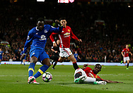 Eric Bailly of Manchester United slides in to block a shot by Romelu Lukaku of Everton during the English Premier League match at Old Trafford Stadium, Manchester. Picture date: April 4th 2017. Pic credit should read: Simon Bellis/Sportimage
