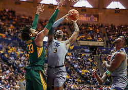 Mar 7, 2020; Morgantown, West Virginia, USA; West Virginia Mountaineers forward Gabe Osabuohien (3) shoots in the lane against Baylor Bears forward Freddie Gillespie (33) during the second half at WVU Coliseum. Mandatory Credit: Ben Queen-USA TODAY Sports