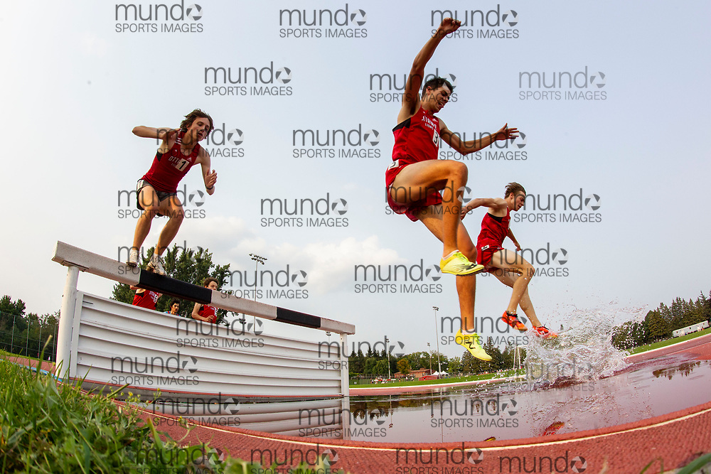 (Ottawa, Canada---04 August 2021) Andrew Taylor (3) and Jackson Roy (1) competing in the 200m steeplechase at Ottawa Summer Twilight Series 2021 Meet #14, held at the Terry Fox Athletic Facility. Photograph 2021 Copyright Sean Burges / Mundo Sport Images.<br /> <br /> If you post on social media please tag @mundosportimages on Instagram or tag Mundo Sport Images on Facebook.