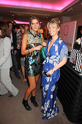 Left to right, VIOLET VON WESTENHOLTZ and OLIVIA BUCKINGHAM at the annual Sotheby's Summer Party held at their auction rooms 34-35 New Bond Street, London W1 on 19th June 2008.<br />