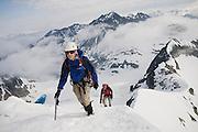 Climbers (l-r) Jim Prager and Obadiah Reid climb the NE Arete of Wedge Mountain in Garibaldi Provincial Park, British Columbia, Canada on June 14, 2009.