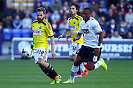 Brentfords' Alan Judge shields the ball from Bolton Wanderers' Neil Danns. Skybet football league championship match, Bolton Wanderers v Brentford at the Macron stadium in Bolton, Lancs on Saturday 25th October 2014.<br /> pic by Chris Stading, Andrew Orchard sports photography.