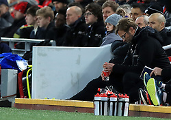 Liverpool manager Jurgen Klopp (right) appears dejected in the dugout during the Emirates FA Cup, fourth round match at Anfield, Liverpool.