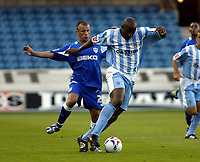 Photo: Chris Ratcliffe, Digitalsport<br /> Millwall v Coventry City. Coca Cola Championship.<br /> 09/08/2005.<br /> Jody Morris of Millwall tussles it out with Dele Adebola  of Coventry