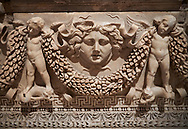 """Picture of Roman relief sculpted Sarcophagus of Garlands, 2nd century AD, Perge. This type of sarcophagus is described as a """"Pamphylia Type Sarcophagus"""". It is known that these sarcophagi garlanded tombs originated in Perge and manufactured in the sculptural workshops of Perge. Antalya Archaeology Museum, Turkey..<br /> <br /> If you prefer to buy from our ALAMY STOCK LIBRARY page at https://www.alamy.com/portfolio/paul-williams-funkystock/greco-roman-sculptures.html . Type -    Antalya    - into LOWER SEARCH WITHIN GALLERY box - Refine search by adding a subject, place, background colour, etc.<br /> <br /> Visit our ROMAN WORLD PHOTO COLLECTIONS for more photos to download or buy as wall art prints https://funkystock.photoshelter.com/gallery-collection/The-Romans-Art-Artefacts-Antiquities-Historic-Sites-Pictures-Images/C0000r2uLJJo9_s0"""