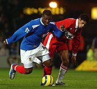 Fotball<br /> England 2004/2005<br /> Foto: BPI/Digitalsport<br /> NORWAY ONLY<br /> <br /> Portsmouth v Middlesborough 1/2/2005.<br /> Barclays Premiership.<br /> Portsmouth's Yakubu battles with Boro's Michael Reiziger