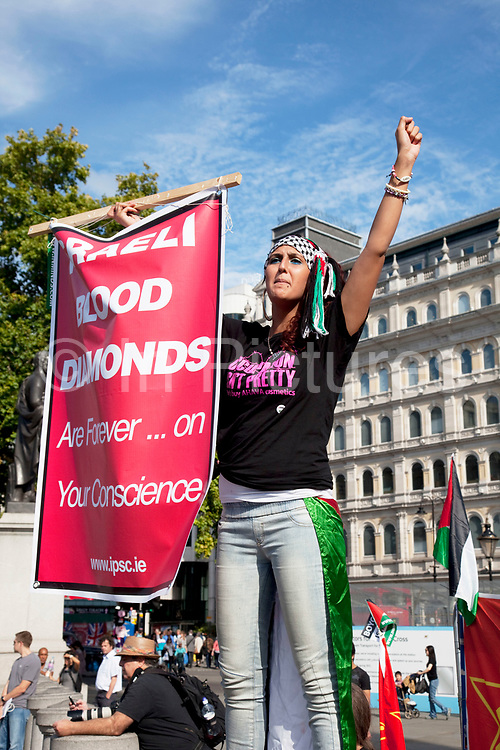 Young woman shouting her protest regarding Israeli blood diamonds as Palestinians demonstrate in central London Al-Quds Day during the last week of Ramadan in support of the rights of the Palestinian people and to end the more than 60 years of Israeli occupation and mistreatment. Also to boycott Israeli goods and to make people aware that allegedly one third of Israel's diamonds in circulation are effectively 'blood diamonds'.