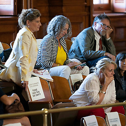 The Texas House debating SB 7 late into the night  a controversial omnibus elections bill that would make changes to the way Texas elections are held.  Members of the public keep tabs on the vote in the House gallery.