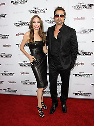 File Photo: 10 August 2009 - Hollywood, California - Brad Pitt and Angelina Jolie. Inglourious Basterds Premiere Held at The Grauman Chinese Theatre. Photo Credit: Kevan Brooks/AdMedia