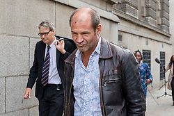 © Licensed to London News Pictures. 31/07/2018. London, UK. Former British soldier James Matthews leaves the Old Bailey after terror charges against him for fighting with a Kurdish militia group against ISIS were dropped. Photo credit: Rob Pinney/LNP