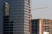 Moscow, Russia, 14/05/2006..New skyscrapers arise on the site of the Moscow International Business Centre, also known as Moskva Citi. The MIBC is Russia's largest construction project, and when completed the riverside site will comprise an entire new business district, housing the Moscow City government, numerous offices, luxury apartments, and the Federation Tower, planned to be Europe's tallest building.