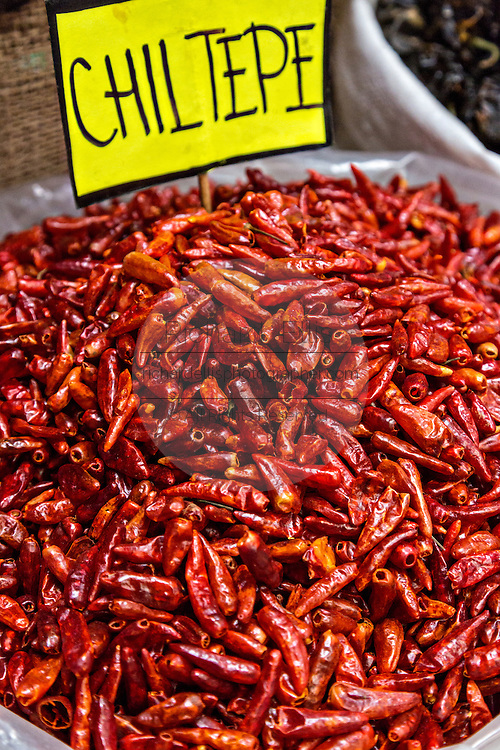 Dried red hot chiltepe chili and pepper at Benito Juarez market in Oaxaca, Mexico.