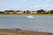 Sailing boat yacht on River Deben view from Sutton, Suffolk, England, UK