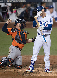 November 1, 2017 - Los Angeles, CA, USA - The Los Angeles Dodgers' Cody Bellinger reacts after a bad swing as Houston Astros catcher Brian McCann throws the ball in the third inning of Game 7 of the World Series at Dodger Stadium in Los Angeles, CA on Wednesday, November 1, 2017. (Credit Image: © Kevin Sullivan/Los Angeles Daily News via ZUMA Wire)