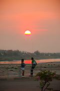 Vientiane, Laos. Mekong RIver park at sunset.