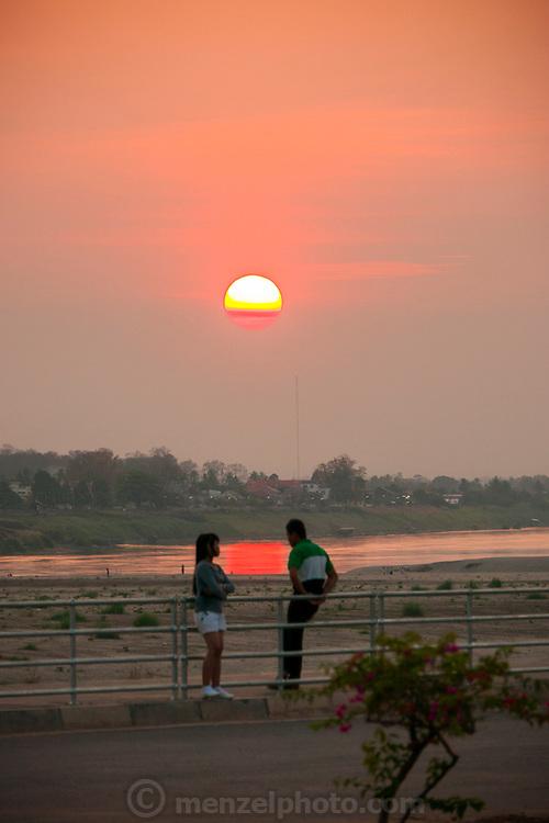 Vientiane, Laos. Mekong RIver park at sunset.