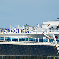 ISOLA DEL GIGLIO, ITALY - SEPTEMBER 18:  A Concordia sign  is seen on the top of the Costa Concordia on September 18, 2013 in Isola del Giglio, Italy. The vessel, which sank on January 12, 2012, was successfully righted during a painstaking operation yesterday morning. The ship will eventually be towed away and scrapped. ItÊwas the first time the procedure, known as parbuckling, hadÊbeen carried out on a vessel as large as Costa Concordia.  (Photo by Marco Secchi/Getty Images)