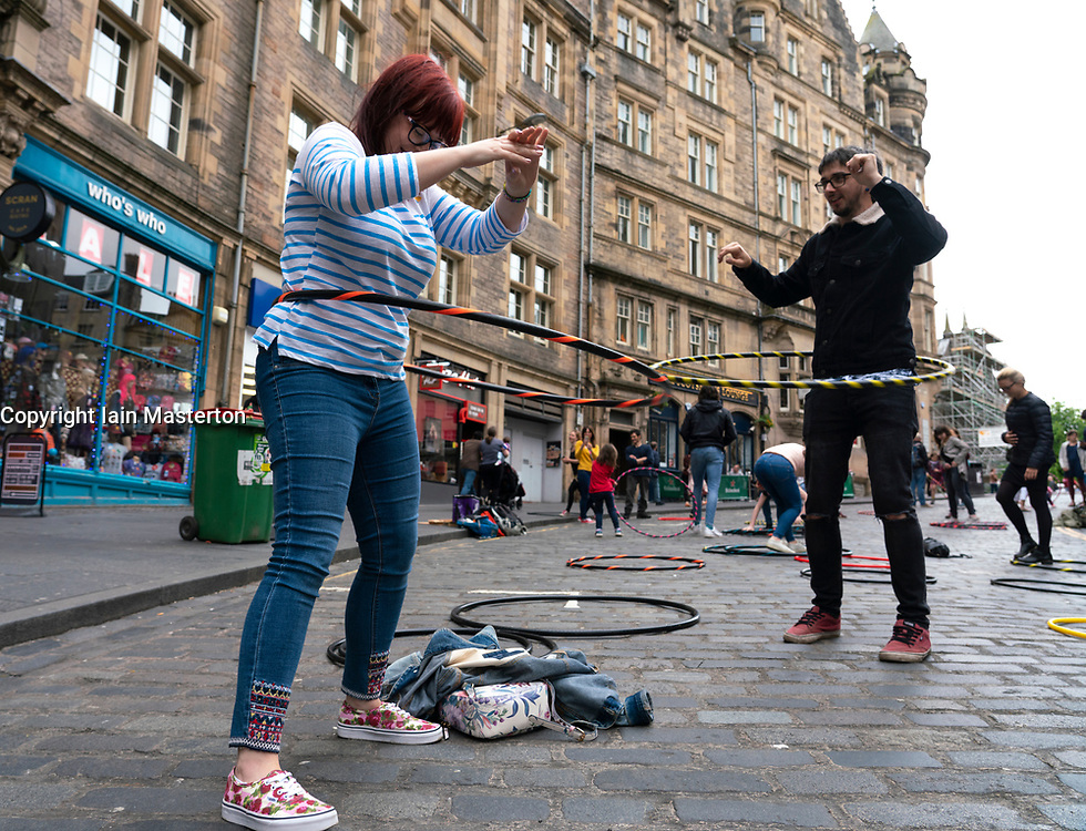 Public using hoola hoops on Cockburn Street during Open Streets Day on 2 June 2019 in Edinburgh Old Town, Scotland, UK