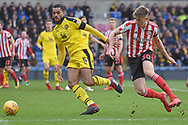 Oxford United defender Curtis Nelson (5) closes down Sunderland defender Jimmy Dunne (30) during the EFL Sky Bet League 1 match between Oxford United and Sunderland at the Kassam Stadium, Oxford, England on 9 February 2019.