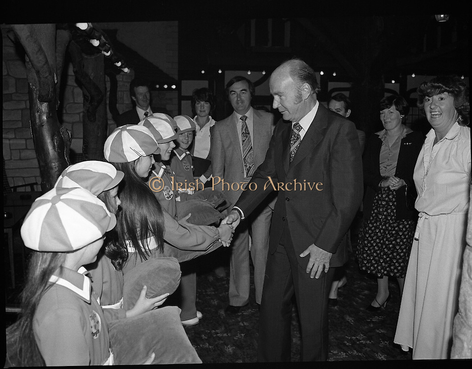 President Hillery at The Community Games..1979..15.09.1979..09.15.1979..15th September 1979..President Patrick Hillery attended the opening of The National Community Games finals at Mosney, Co Meath today. The finals were held in the grounds of The Butlins Holiday Centre and were sponsored by Tayto Irl Ltd,Greencastle Road,Coolock,Dublin..Photograph shows President Hillery meeting the young 'Tayto' girls at the Community Games in Mosney, Co Meath.